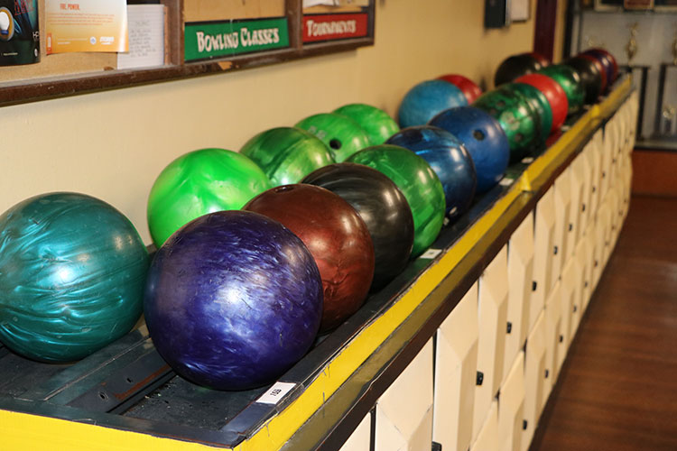 Row of bowling balls at Crenshaw Lanes