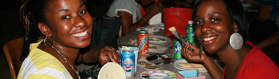 Photo of students participating in Paint-A-Pot