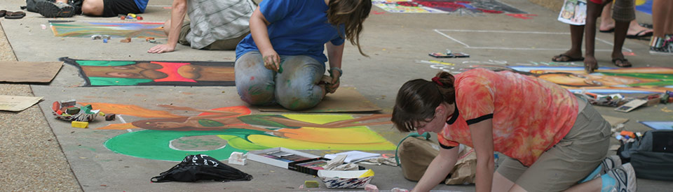 Photo of students creating sidewalk chalk art