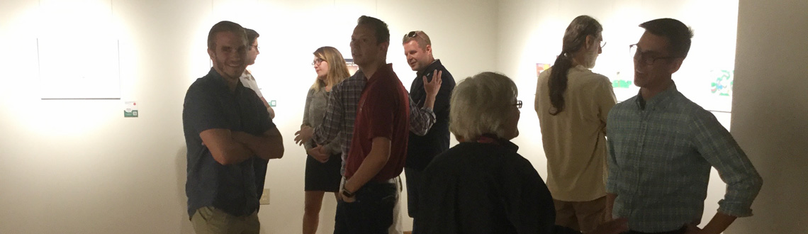 Photo of spectators admiring work in the Oglesby Gallery
