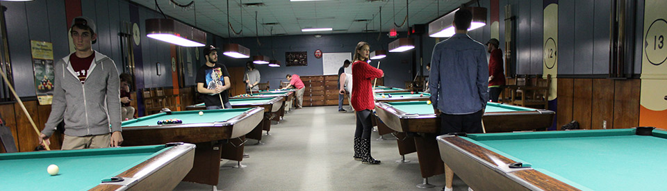 Photo of students playing billiards