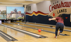 Photo of a student bowling at Crenshaw Lanes